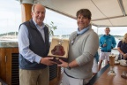 HM King Juan Carlos of Spain presents Hennessy Paradis Imperiale to Peter Dubens, owner of yacht Spectre at the Prizegiving of the Hennessy BlueBird Cup 2015